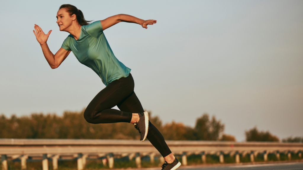 Young woman running intervals in order to lose weight